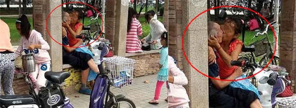 郑州老汉与中年女子街头激吻 身旁孩童熟视无睹