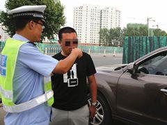 青岛曝光46名酒司机 酒司机辩称喝了藿香正气水